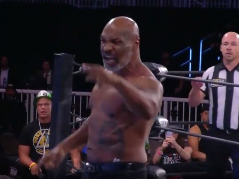 Mike Tyson looking ripped as he confronts Jake 'The Snake' Roberts in AEW appearance