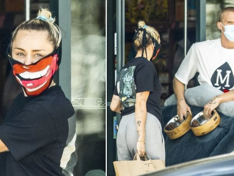 Miley Cyrus covers up with tongue design face mask that's a blast from her Bangerz past