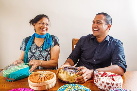Sanjay Aggarwal and his mother Shashi preparing traditional spice tins for their business, Spice Kitchen