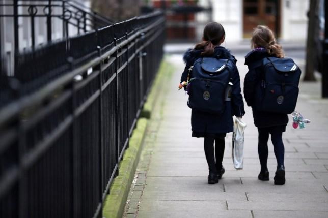 Stock image of children leaving school