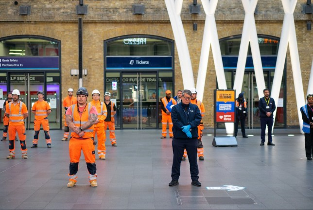 Rail LNER, Thameslink, Great Northern and auxiliary staff at King Cross station hold a minute's silence, which has been held across the UK to commemorate the key workers who have died with coronavirus. A minute's silence, being at King Cross station o commemorate the key workers who have died with coronavirus., London, UK - 28 Apr 2020 Mandatory Credit: Photo by Wayne Tippetts/REX (10626974a)