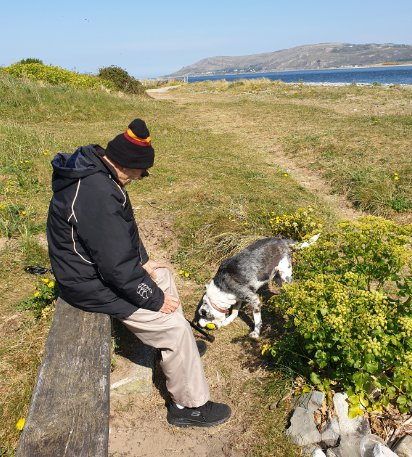 A PENSIONER was gifted a stroll on the beach to mark his 78th birthday. Arthur Hughes has walked the same daily route - along the beach in Conwy - with his dog Cassie for the past five years but due to current lockdown measures, he hasn't been able to get out. Daughter Michelle Stockham wanted to organise something special for her father's birthday. Pictured here is Arthur Hughes and his dog. ? WALES NEWS SERVICE