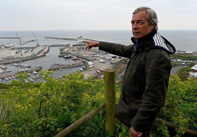 PHOTO:STEVE FINN 07968894444 PICTURE SHOWS: Former MEP Nigel Farage Today As Up To Sixteen Migrants Including A Baby Wrapped In A Blue Blanket That Have Crossed The English Channel By Boat Today.They Are Dealt With By Border Force And Immigration Officials.Dover Harbour.Dover.Kent.Uk.Today.04/05/20. VIDEO AVAILABLE SPEC???IMAGE NO SYNDICATION FOR SOCIAL MEDIA USAGE PLEASE CHECK WITH THE COPYRIGHT HOLDER PRIOR. NON FEE PAYING WEBSITES THAT HAVE STOLEN AND USED IMAGE WILL BE CHARGED ACCORDINGLY. SEPARATE ONLINE FEE AND PAPER FEE APPLIES.INDIVIDUAL TITLE FEE ALSO. stevefinnphotography@yahoo.co.uk