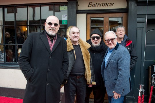 GUILDFORD, ENGLAND - JANUARY 31: Barry Baz Warne, Dave Greenfield, Jet Black and Jean-Jacques Burnel of The Stranglers and PRS for Music Chairman Nigel Elderton present The Starr Inn with the PRS for Music Heritage Award on January 31, 2019 in Guildford, England. (Photo by Ollie Millington/Getty Images)