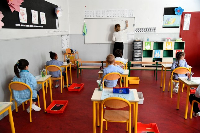 BGUK_1930701 - Nice, FRANCE - Teachers and students wearing face mask at Baumettes-Simone Veil school in Nice, France, as the schools in France are to gradually reopen from today when a partial lifting of restrictions due to the Covid-19 pandemic caused by the novel coronavirus comes into effect. New hygiene measures and implementation of barrier actions to limit the risks of contamination. Pictured: GV, General View BACKGRID UK 12 MAY 2020 BYLINE MUST READ: BEST IMAGE / BACKGRID UK: +44 208 344 2007 / uksales@backgrid.com USA: +1 310 798 9111 / usasales@backgrid.com *UK Clients - Pictures Containing Children Please Pixelate Face Prior To Publication*