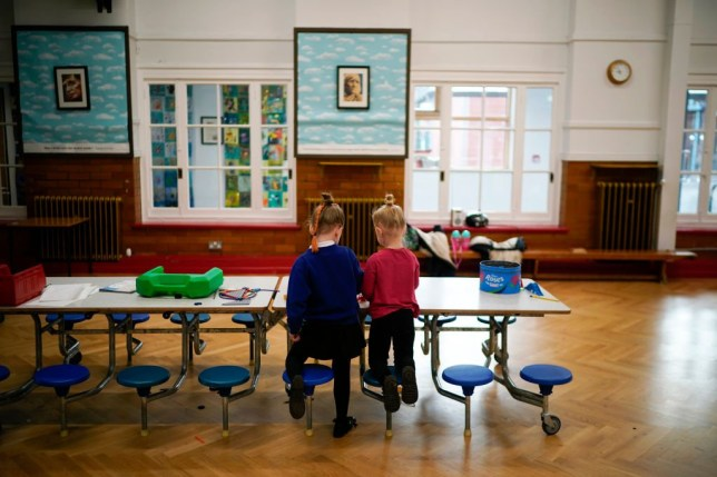 Two pupils pictured in a school classroom