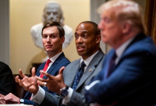 epa08430706 Jared Kushner, left, looks on as US President Donald J. Trump and as Scott Turner, Executive Director of the White House Opportunity and Revitalization Council, left, makes remarks as they participate in a meeting on Opportunity Zones in the Cabinet Room of the White House, Washington, DC, USA, 18 May 2020. EPA/Doug Mills / POOL