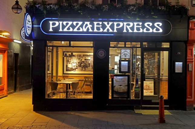 A PizzaExpress Ltd. restaurant sits empty in the West End district in London, U.K., on Friday, March 20, 2020. A shutdown of the U.K. capital would hit the night-time economy hard -- one in three employees in London works between 6 p.m. and 6 a.m., many in the pubs, restaurants and clubs most at risk of survival because of the pandemic. Photographer: Simon Dawson/Bloomberg via Getty Images