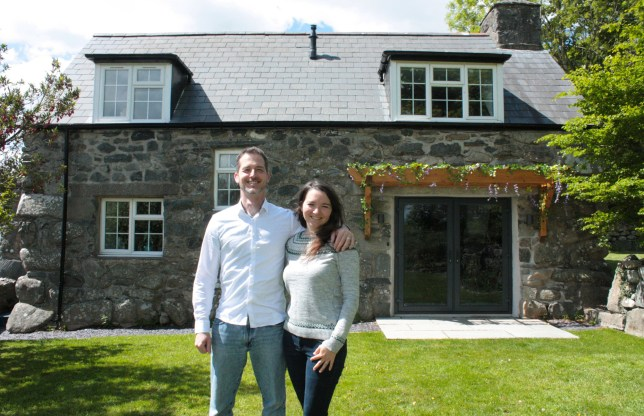 Ryan Mclean and Katherine Jablonowska in front of the cottage after its renovation