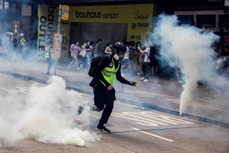 Police fire tear gas on protesters during a planned protests against a proposal to enact a new security legislation in Hong Kong on May 24, 2020. - The proposed legislation is expected to ban treason, subversion and sedition, and follows repeated warnings from Beijing that it will no longer tolerate dissent in Hong Kong, which was shaken by months of massive, sometimes violent anti-government protests last year. (Photo by ISAAC LAWRENCE / AFP) (Photo by ISAAC LAWRENCE/AFP via Getty Images)