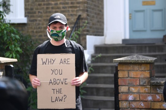 A protester outside the north London home of Prime Minister Boris Johnson's senior aide Dominic Cummings , as lockdown questions continue to bombard the Government after it emerged that he travelled to his parents' home despite coronavirus-related restrictions. PA Photo. Picture date: Sunday May 24, 2020. See PA story HEALTH Coronavirus. Photo credit should read: Victoria Jones/PA Wire