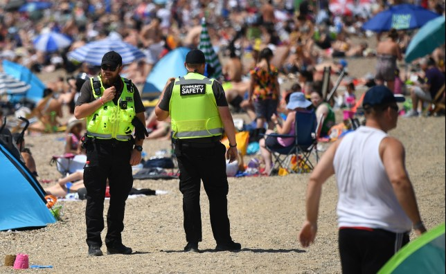 Community Safety officers, employed by the local Council, patrol the beach to ensure beachgoers do not drink alcohol, and to try to enforce social distancing measures, in Southend-on-Sea, south east England on May 25, 2020, after lockdown restrictions, originally put in place due the COVID-19 pandemic, were lifted earlier this month. - British Prime Minister Boris Johnson on Sunday backed top aide Dominic Cummings despite mounting pressure from within his own party to sack him over claims he broke coronavirus lockdown regulations. (Photo by Ben STANSALL / AFP) (Photo by BEN STANSALL/AFP via Getty Images)