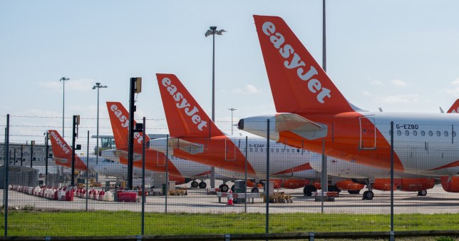 LONDON, ENGLAND - APRIL 14: A general view of Easyjet passenger planes parked at Southend Airport on April 14, 2020 in London, United Kingdom. EasyJet has currently grounded its entire fleet of planes because of the ongoing coronavirus crisis. The Coronavirus (COVID-19) pandemic has spread to many countries across the world, claiming over 120,000 lives and infecting over 1.9 million people. (Photo by John Keeble/Getty Images)