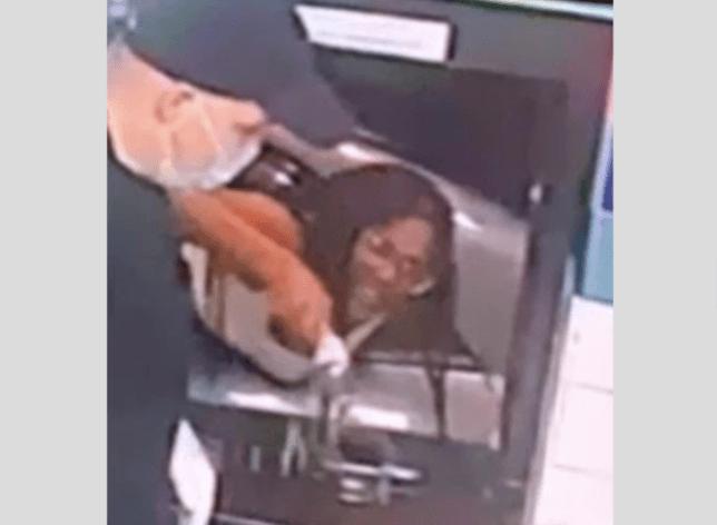 Grab of woman throwing bottle of poop and pee through drive-thru window