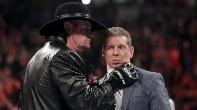 WWE legend The Undetaker chokes chairman Vince McMahon