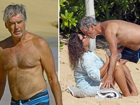 Pierce Brosnan channels his inner James Bond and plants a kiss on wife Keely Shaye Smith in Hawaii