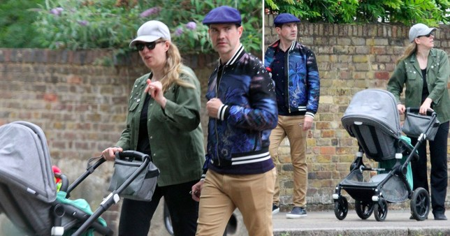 Comedian Jimmy Carr and his girlfriend Karoline Copping push a baby pram on a walk around Primrose Hill