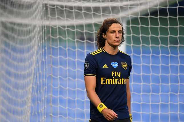 David Luiz looks dejected after his sending off in Arsenal's Premier League defeat at Manchester City