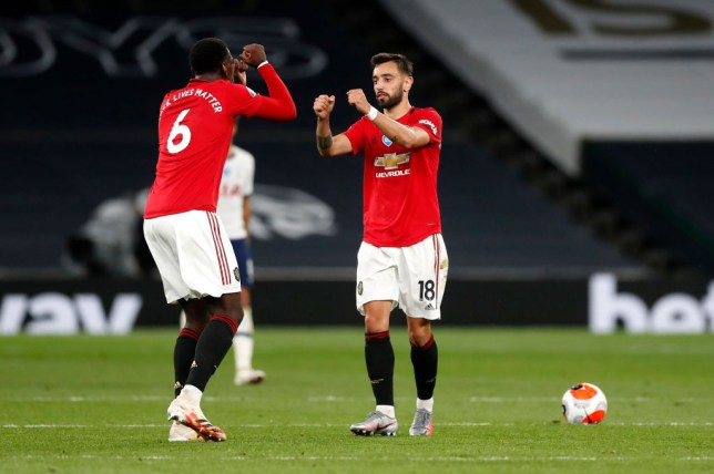 Paul. Pogba and Bruno Fernandes fist bump during Tottenham Hotspur v Manchester United