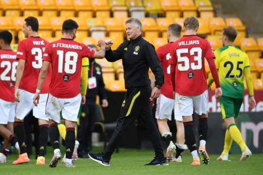 Ole Gunnar Solskjaer, Manager of Manchester United interacts with Bruno Fernandes of Manchester United after the FA Cup Quarter Final match between Norwich City and Manchester United at Carrow Road on June 27, 2020 in Norwich, England.