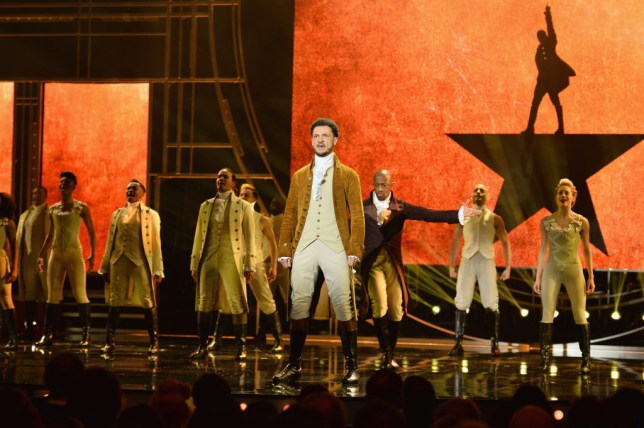 Hamilton actors on stage