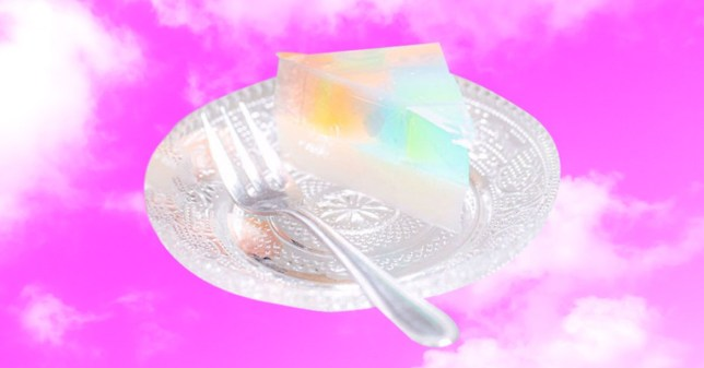 A slice of prism rainbow cake on a plate against a purple/pink background