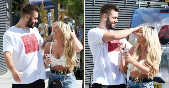 Paige Turley and Finley Tapp looking loved-up during walk in Manchester