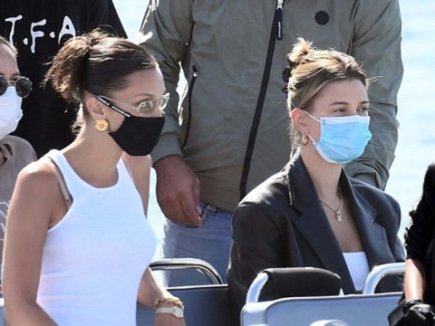 Bella Hadid and Hailey Baldwin spotted in face masks on their way home from Sardinia after three-day photoshoot