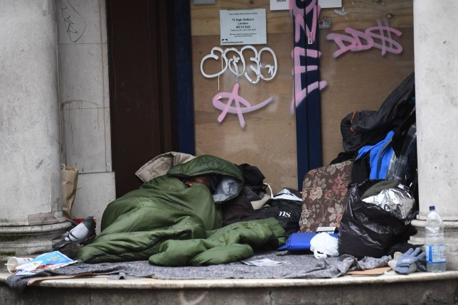 File photo dated 28/01/20 of a homeless man sleeping in a doorway. The Local Government Secretary has warned there is still more work to be done to help rough sleepers, claiming 90% of them have been offered accommodation during the coronavirus crisis. PA Photo. Issue date: Saturday April 18, 2020. See PA story HEALTH Coronavirus. Photo credit should read: Victoria Jones/PA Wire