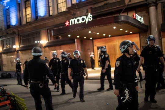 Police arrive at Macy's mall after it was broken into by people hours after a solidarity rally calling for justice over the death of George Floyd Monday, June 1, 2020, in New York. Floyd died after being restrained by Minneapolis police officers on May 25. (AP Photo/Wong Maye-E)
