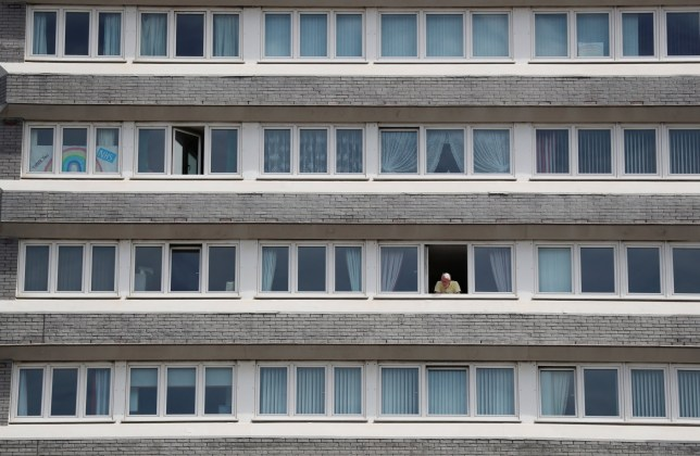 A man looks out of his window in Sunderland, following the outbreak of the coronavirus disease (COVID-19), Sunderland, Britain, June 2, 2020. REUTERS/Lee Smith