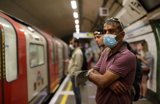 people wearing face coverings on the london underground