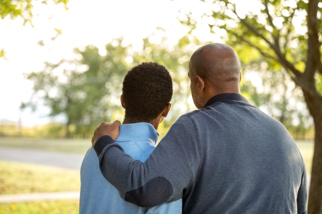 African American father and son talking