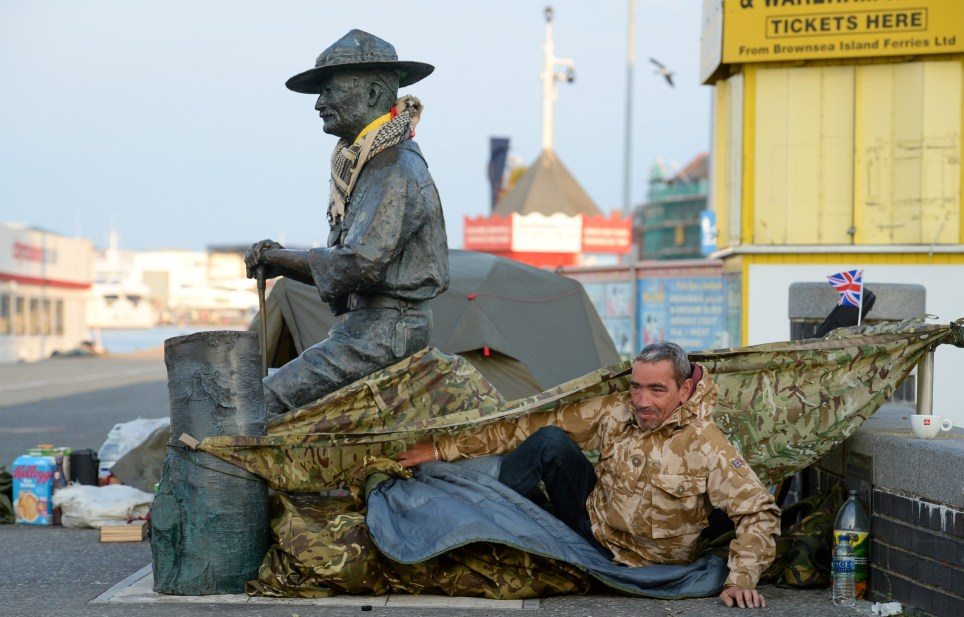 POOLE, ENGLAND - JUNE 12: Former soldier Stephen McCartan wakes up at his shelter set up to protect the Lord Baden-Powell statue on June 12, 2020 in Poole, United Kingdom. The statue of Robert Baden-Powell on Poole Quay is to be placed into safe storage after campaigners have accused him of racism, homophobia and support for Adolf Hitler. (Photo by Finnbarr Webster/Getty Images)