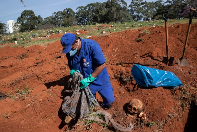 A cemetery worker exhumes the body of a person buried three years ago