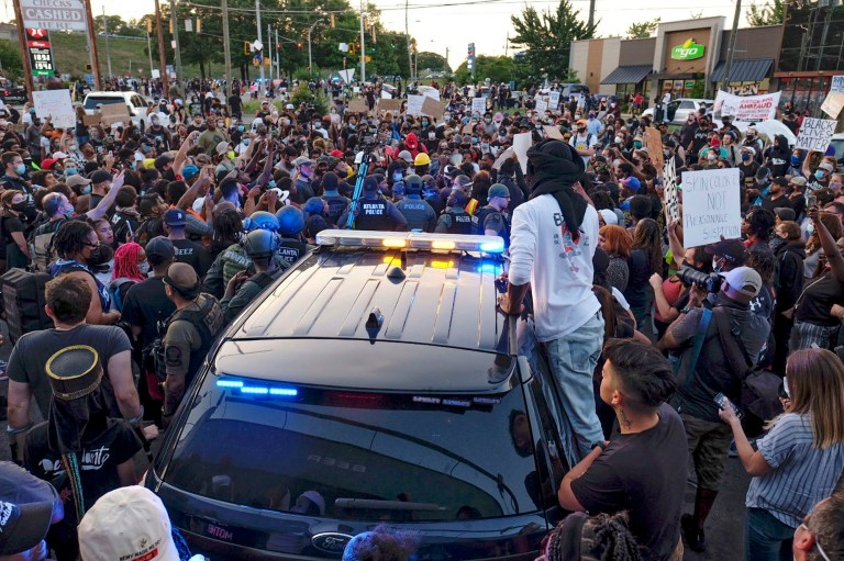 Police attempt to control protestors outside a Wendy's restaurant Saturday, June 13, 2020 in Atlanta. Georgia authorities said Saturday a man was shot and killed in a late night struggle with Atlanta police outside a fast food restaurant after he failed a field sobriety test and resisted arrest.