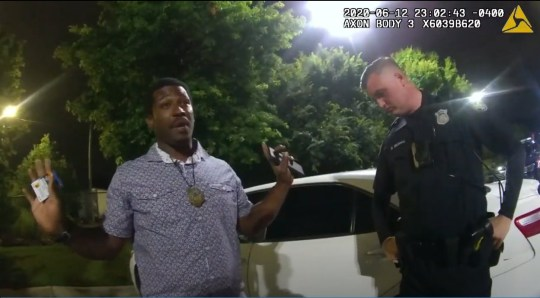 Names of officers involved in #RayshardBrooks shooting identified. Officer Garrett Rolfe (left) has since been terminated. Officer Devin Bronsan (right) has been placed on administrative duty. ===Atlanta Police Chief Erika Shields resigned on Saturday less than 24 hours after the shooting Rayshard Brooks, 27, was shot and killed near a Wendy's drive-thru in Atlanta late on Friday night Two Atlanta police officers were called to scene at around 10:30pm on University Avenue on Friday Cops received reports of a man who fell asleep in his car as it stood near the drive-thru window Police say Brooks failed a field sobriety test and video shows him fighting with officers Brooks is then seen grabbing a Taser from one of the officers and running away as two cops gave chase New surveillance video shows Brooks turning and pointing an object at cops, which they say is a taser Officers opened fire and Brooks was pronounced dead at a nearby hospital