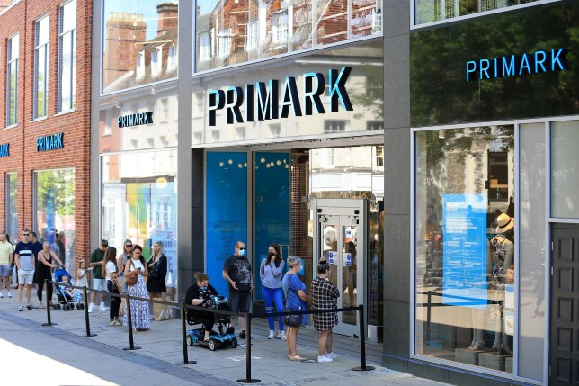People queuing outside a Primark