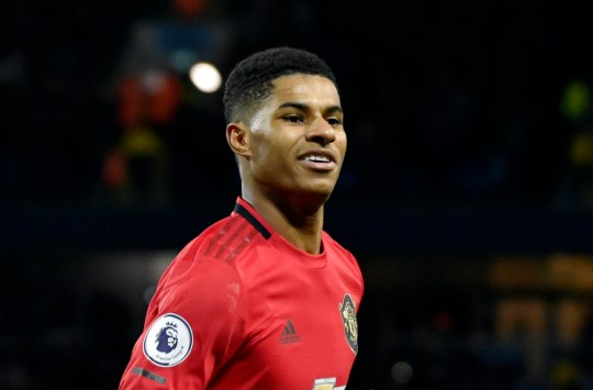 FILE - In this Saturday, Dec. 7, 2019 file photo, Manchester United's Marcus Rashford celebrates during an English Premier League soccer match against Manchester City at Etihad stadium in Manchester, England. British Prime Minister Boris Johnson faced growing pressure Tuesday, June 16, 2020 to make a policy U-turn as opponents and allies alike rallied behind a young soccer star???s campaign to help families struggling with food poverty. Manchester United and England player Marcus Rashford is urging the government to provide free meals for needy students over the summer holidays.(AP Photo/Rui Vieira, file)