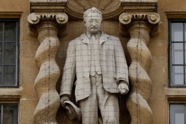 A statue of Cecil Rhodes, the controversial Victorian imperialist who supported apartheid-style measures in southern Africa stands mounted on the facade of Oriel College in Oxford, England, Wednesday, June 17, 2020.
