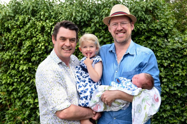 Proud dads Al and Alan with daughter Beatrice and newborn Otto