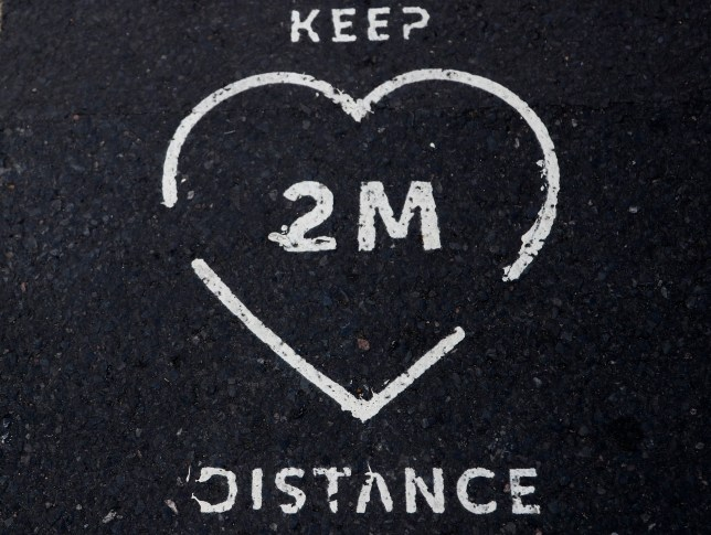 A two meter distance print on the pavement in London