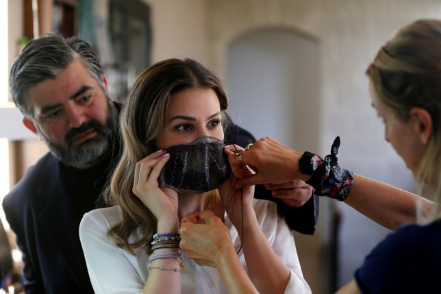 Jordanian chef Omar Sartawi and designers Princess Nejla Asem and Salam Dajani work to design sustainable face masks using eggplant skin, during the outbreak of the coronavirus disease (COVID-19), at Dajani's workshop in Amman, Jordan, June 8, 2020. Picture taken June 8, 2020. REUTERS/Muhammad Hamed