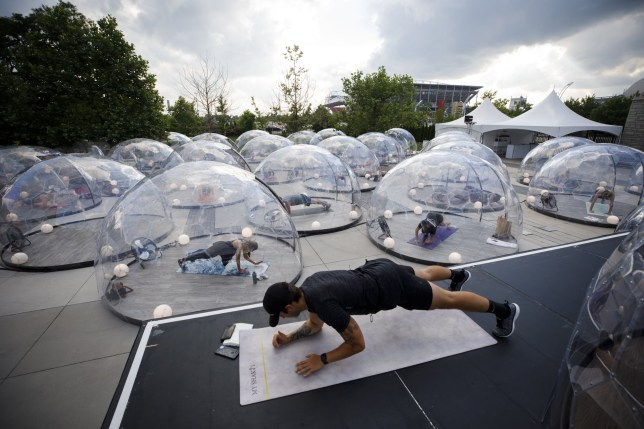 TORONTO, ON - JUNE 23: People participate in an outdoor yoga class at Hotel X, inside domes to comply with social distancing measures to control the spread of Covid-19, June 23, 2020 in Toronto, Canada. As Canada begins to reopen its economy following Covid-19 shutdowns, gyms and fitness centres still remain closed as they determine how to comply with social distancing measures. (Photo by Cole Burston/Getty Images)