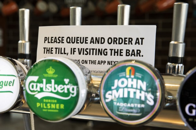 LONDON, ENGLAND - JUNE 25: A sign on the beer taps at the bar at a branch of Weatherspoons in Muswell Hill as it prepares for re-opening, on June 25, 2020 in London, United Kingdom. Weatherspoons is looking to open 750 of its pubs on July 04. The UK Government announced that Pubs, Hotels and Restaurants can open from Saturday, July 4th providing they follow guidelines on social distancing and sanitising. (Photo by Dan Kitwood/Getty Images)
