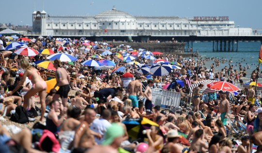 People at Brighton beach after lockdown eases