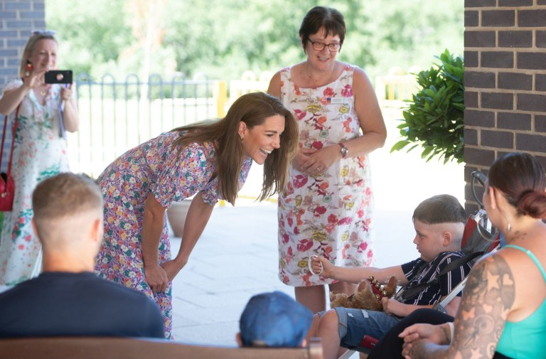 EMBARGOED: No onward transmission before 2100 BST Sat 27/6/2020. Not for publication before 2200 BST Sat 27/6/2020. The Duchess of Cambridge meets Sonny Saunders and his family, including mother Kelly (right, back to camera) and father Jordan (left, back to camera) during a visit to The Nook in Framlingham Earl, Norfolk, which is one of the three East Anglia Children's Hospices (EACH). Sonny was diagnosed with a diffuse intrinsic pontine glioma, an aggressive and difficult-to-treat brain tumour, only a week or so after his sixth birthday in February. PA Photo. Picture date: Thursday June 25, 2020. The Duchess is the Royal Patron of the charity which offers care and support for children and young people with life-threatening conditions and their families across Cambridgeshire, Essex, Norfolk and Suffolk. See PA story ROYAL Kate. Photo credit should read: Joe Giddens/PA Wire
