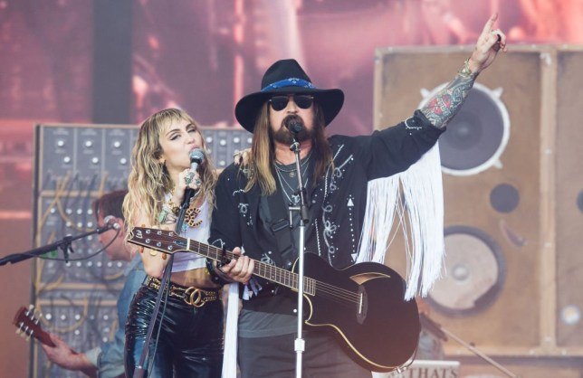 GLASTONBURY, ENGLAND - JUNE 30: Miley Cyrus and Billy Ray Cyrus perform on the Pyramid Stage during day five of Glastonbury Festival at Worthy Farm, Pilton on June 30, 2019 in Glastonbury, England. (Photo by Samir Hussein/WireImage)