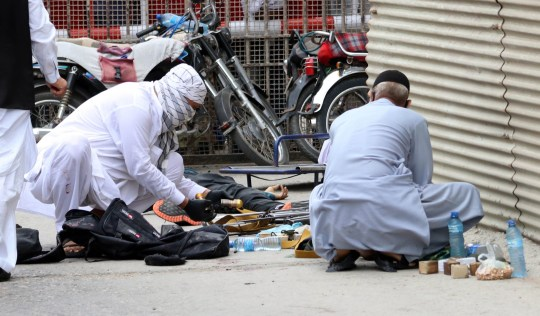 epa08515324 Pakistani security officials inspect weapons and ammunition recovered at the scene of an attack by unknown gunmen at Karachi Stock Exchange in Karachi, Pakistan, 29 June 2020. At least four gunmen and two civilians were reportedly killed and security forces have cordoned off the area as fighting is currently ongoing. EPA/REHAN KHAN