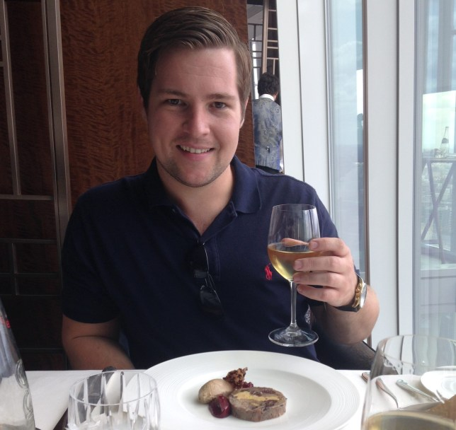 Scott Antcliffe sat at dinner holding a glass of wine